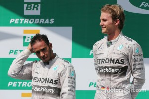 The podium (L to R): second placed Lewis Hamilton (GBR) Mercedes AMG F1 with race winner and team mate Nico Rosberg (GER) Mercedes AMG F1. 09.11.2014. Formula 1 World Championship, Rd 18, Brazilian Grand Prix, Sao Paulo, Brazil, Race Day. - www.xpbimages.com, EMail: requests@xpbimages.com - copy of publication required for printed pictures. Every used picture is fee-liable. © Copyright: Moy / XPB Images